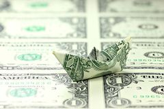 US Dollar paper boat Royalty Free Stock Photos