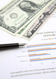 US dollar and pen on chart Royalty Free Stock Image