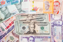 US Dollar with a pile of Asian currency note Royalty Free Stock Photo