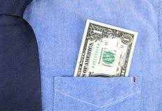 US dollar in pocket of  shirt Stock Image