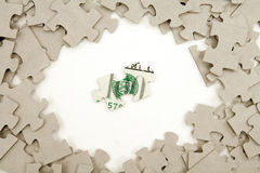 Us dollar and  puzzle Royalty Free Stock Photos