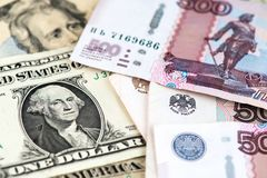 Close up image of one US Dollar bill with Russian Ruble currency. US Dollar and Russian Ruble currency banknotes. Russian Ruble banknotes and US Dollar bill stock photo