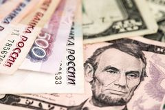 US Dollar and Russian Ruble currency banknotes. US dollar bill and Russian Ruble banknotes close up image. USA Russia Dollar Ruble Russian Ruble banknotes and stock photos