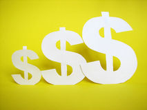 Us dollar sign cut from paper Royalty Free Stock Photo