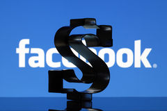 US Dollar sign and Facebook logo Stock Image