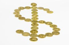 US Dollar sign made of gold coins. On white background with shallow depth of field Stock Photography