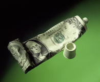 US dollar squeeze on toothpaste tube Royalty Free Stock Photo