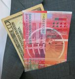 US dollar and Swiss franc banknotes Stock Photography