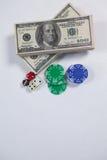 US dollar, tärning och kasinochiper på vit bakgrund Royaltyfri Bild
