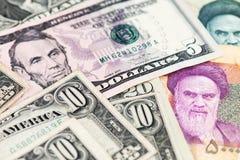 US-Dollar und der Iran-Rialwährung lizenzfreie stockfotografie