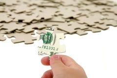 US-Dollar und Puzzlespiel Stockfoto