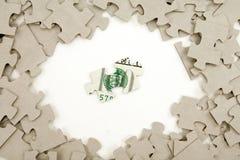 US-Dollar und Puzzlespiel Lizenzfreie Stockfotos