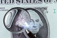 1 US Dollar under magnifying glass Stock Image