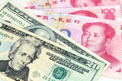 US dollar vs Chinese RMB. Symbol for tug-of-war of currency depreciation and appreciation Stock Photos