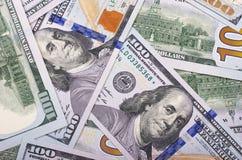 100 US-Dollar Zusammenfassungsgeld-Bargeldhintergrund Stockbilder