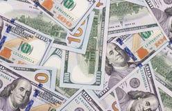 100 US-Dollar Zusammenfassungsgeld-Bargeldhintergrund Stockfotografie
