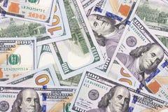 100 US-Dollar Zusammenfassungsgeld-Bargeldhintergrund Stockbild