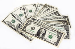 US dollars. US dollar bills spread on white Royalty Free Stock Photo