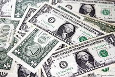 US dollars. US dollar bills spread randomly Royalty Free Stock Images