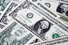 US dollars. US dollar bills spread randomly Stock Image