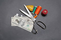 US Dollars and accessories for cutting and sewing. Can you make money sewing. US Dollars and accessories for cutting and sewing Royalty Free Stock Photo