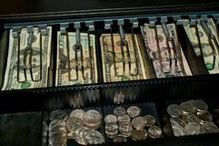 US Dollars And Coins In Open Cash Drawer Royalty Free Stock Images