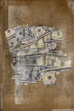 US dollars assorted bills cash on grunge. A pile of cash US dollars assorted bills cash on grunge background Royalty Free Stock Images