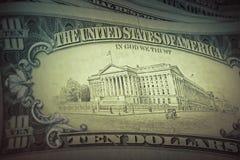 US dollars background, retro style toned photo Royalty Free Stock Images