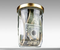 US dollars bank notes in a glass closed jar Stock Images