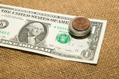 US dollars banknote and coins on an old cloth Royalty Free Stock Photography