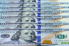 100 US dollars banknotes as a background, perspective view. Stock Images
