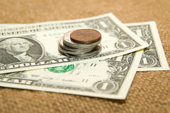 US dollars banknotes and coins on an old cloth Stock Photo