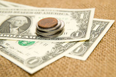 US dollars banknotes and coins on an old cloth Royalty Free Stock Images