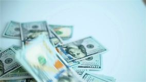 US dollars banknotes falling on white surface. Wages, arnings, winnings. US dollars banknotes falling on white surface. Wages, arnings, winnings, freedom stock footage