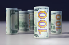 US dollars. Banknotes stacked on each other. 100 US dollars. Banknotes stacked on each other in different positions. American dollar. US dollarr Royalty Free Stock Image