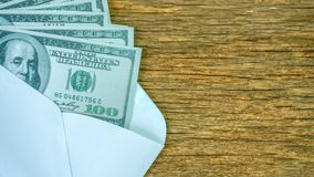 US dollars bills in envelope on the wooden royalty free stock photo