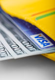 US dollars bills and Visa credit card in wallet. Royalty Free Stock Photo