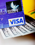 US dollars bills  in wallet and Visa credit card Stock Images