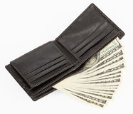 US dollars in a black purse Stock Photos