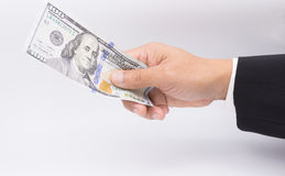 US dollars in business hand isolated on a white Stock Image
