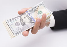 US dollars in business hand  on a white Royalty Free Stock Photography