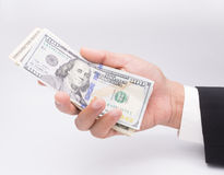 US dollars in business hand  on a white Stock Photo
