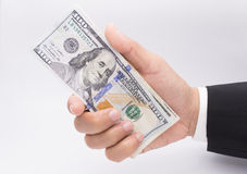 US dollars in business hand  on a white Royalty Free Stock Photos