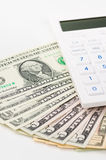 US Dollars and Calculator Royalty Free Stock Photos