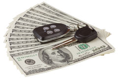 Us dollars and car keys isolated Stock Photos