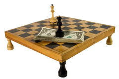 US dollars and chess figures. On a chessboard resting upon rooks (isolated on white Stock Photos