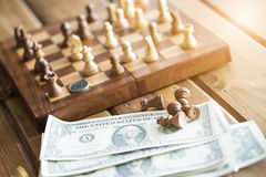 US dollars and chess figures Royalty Free Stock Photography