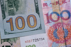 US dollars and Chinese 100 bill Royalty Free Stock Photos