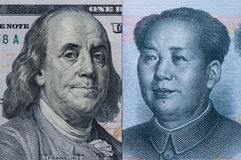 US dollars and Chinese Yuan bill Royalty Free Stock Photos