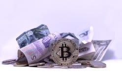US Dollars, Chinese Yuan and Bitcoin Coin royalty free stock photo